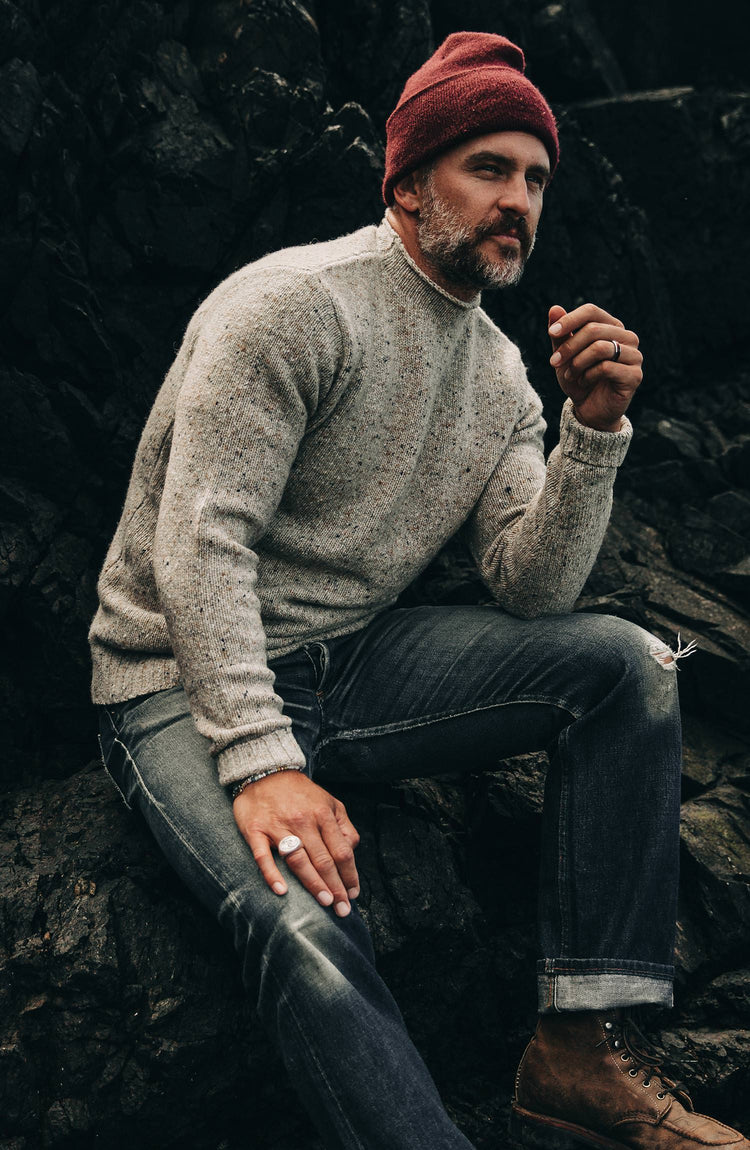 our guy on the coast wearing the seafarer—with text overlaying