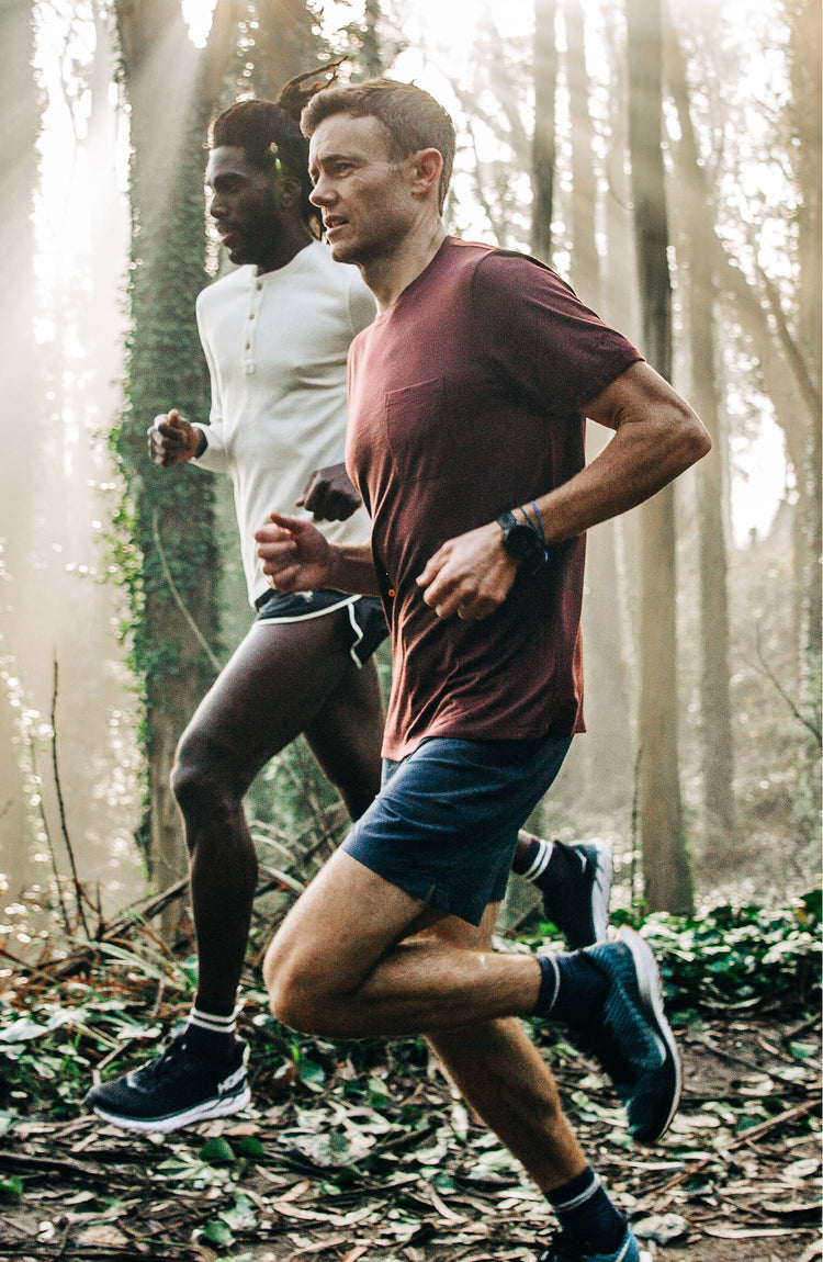 Our guy rocking The Tracksmith Collection traverse short, on trail