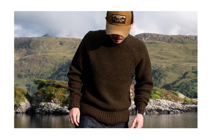 Evan wearing the Fisherman Sweater in Loden in the Scottish Highlands
