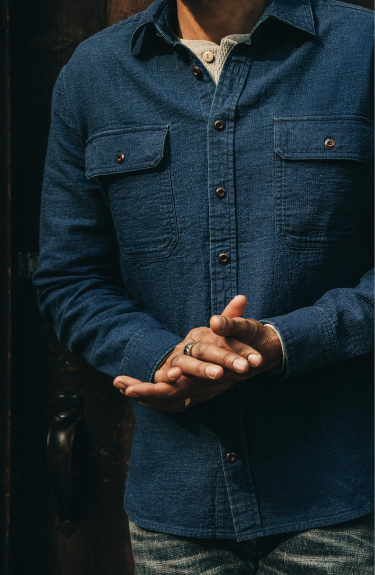our guy wearing The Corso Shirt in Indigo Double Cloth from the front with hands clasped