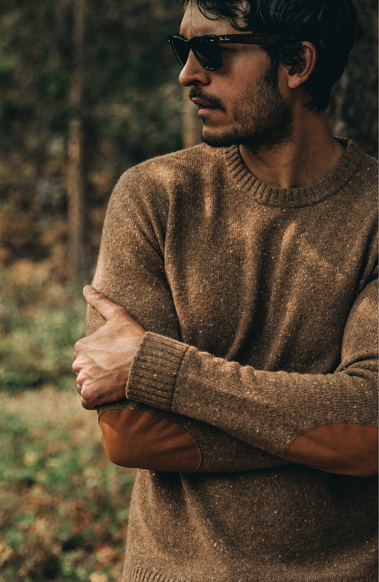 The Hardtack Sweater in Oak Donegal — Model crossing arms and looking over shoulder
