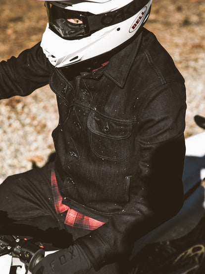 Overhead shot of moto rider showing long haul denim jacket up close.