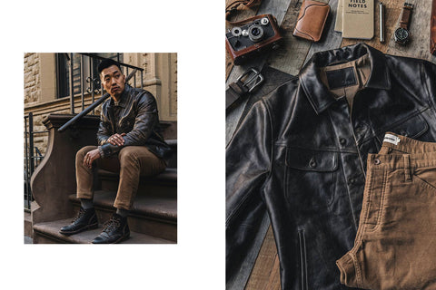 Nate rocking our long haul in cola—right shot featuring a textural laydown of the jacket with a camera beside it
