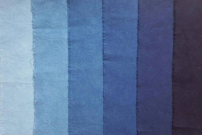a shot of fabric dyed in different tones of indigo