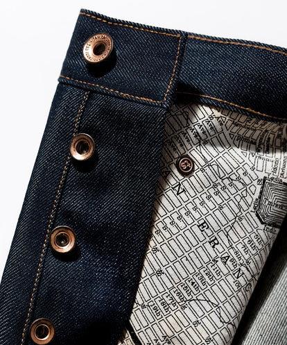SF map material comprising pockets on interior of jeans.