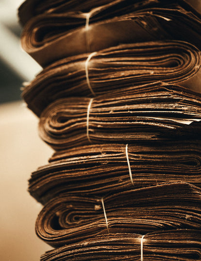 A stack of rolled, folded, and tied-up bundles of leather.