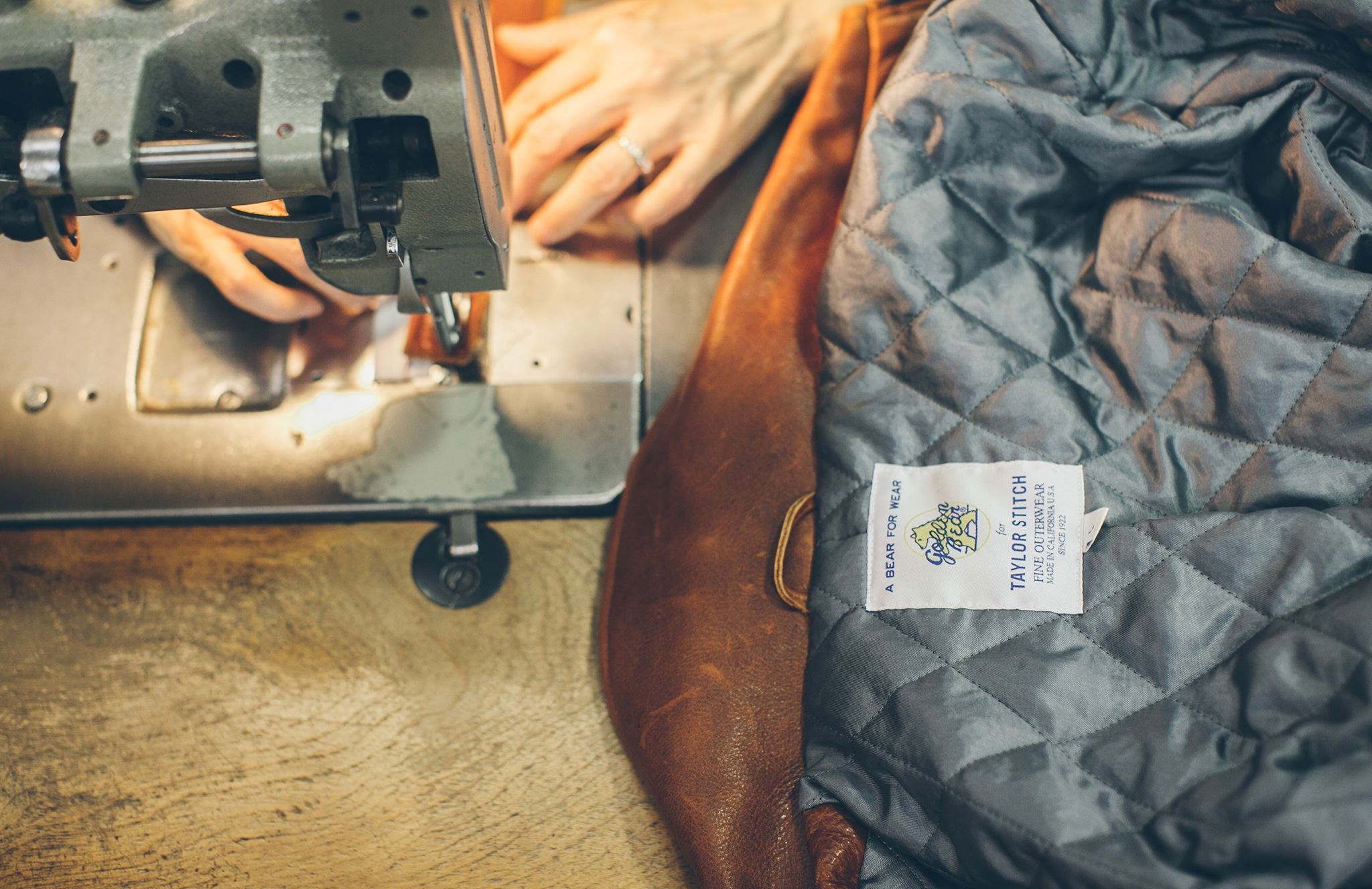 Leather being sewn for our Moto Jacket.