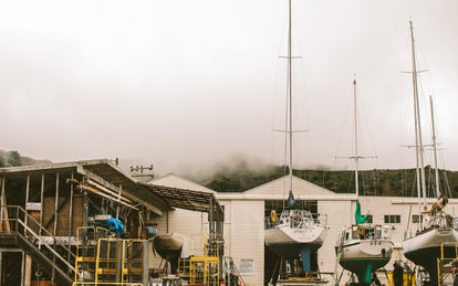 A working marina scene with several dry-docked yachts.