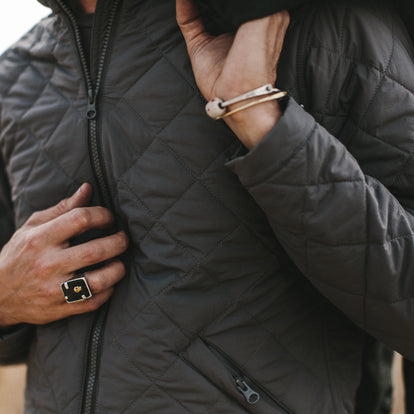 Close up shot of our fit model wearing the vertical jacket