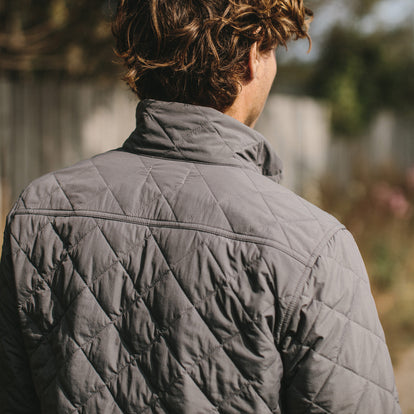 The fit model showing us the back of the vertical jacket in ash