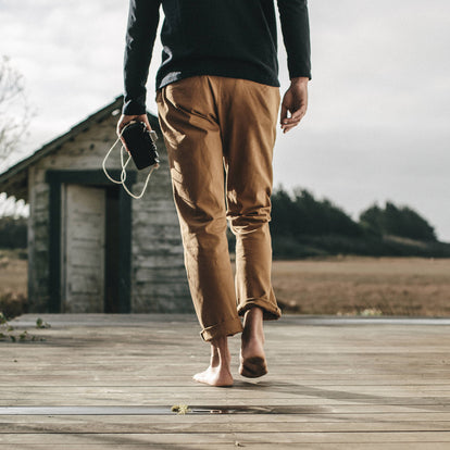 Our fit model wearing The Democratic Chino in Organic British Khaki.