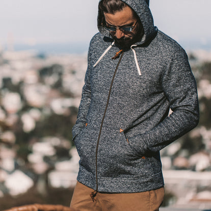 The fit model showing the Apres hoodie zipped up