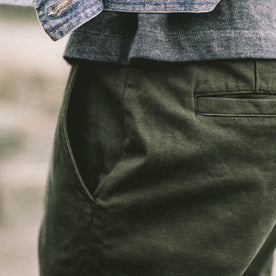 Our fit model wearing The Slim Chino in Organic Olive.