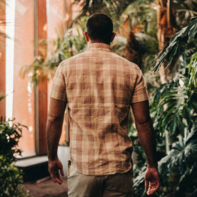 fit model wearing The Short Sleeve Jack in Red Madras, back shot