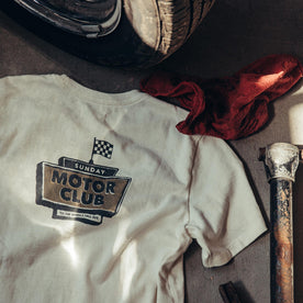 material shot of The Heavy Bag Tee in Motor Club