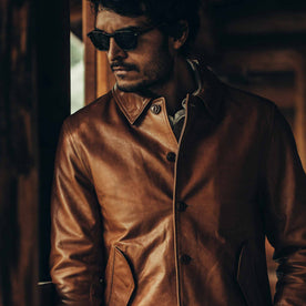 fit model wearing The Cuyama Jacket in Cognac, looking left, sunglasses on