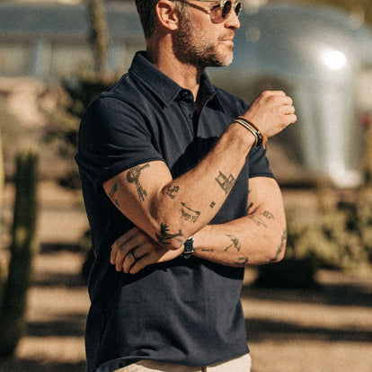 our fit model wearing The Heavy Bag Polo in Navy