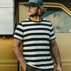 Our fit model wearing The Heavy Bag Tee in Natural & Navy Rugby Stripe by Taylor Stitch.