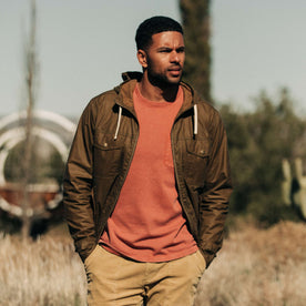 our fit model wearing The Welterweight Winslow in Field Tan Waxed Canvas out in the desert—cropped shot looking left