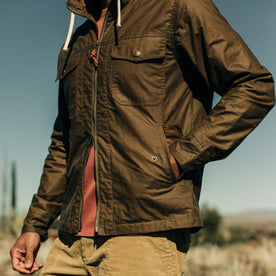 our fit model wearing The Welterweight Winslow in Field Tan Waxed Canvas out in the desert—cropped shot of chest