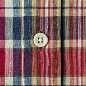 Close up material shot with perpendicular plaid and close up of button
