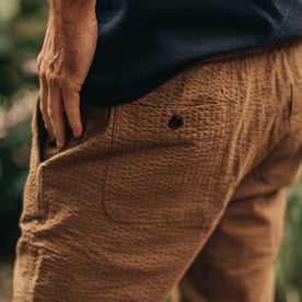 our fit model wearing The Après Pant in British Khaki Seersucker—cropped shot of pant back
