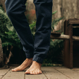 our fit model wearing The Après Pant in Navy Seersucker—cropped shot from knees down