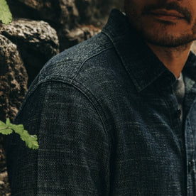 our fit model wearing The Cash Shirt in Indigo Hemp—cropped shot of right shoulder, close up