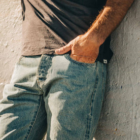 our fit model wearing The Democratic Jean in 24-Month Wash Japanese Selvage—left hand in pocket, close up shot