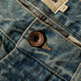 material shot of The Democratic Jean in 24-Month Wash Japanese Selvage—button close up