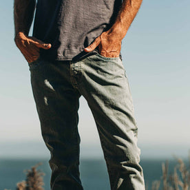 our fit model wearing The Slim Jean in 24-Month Wash Japanese Selvage—on the beach, hands in pockets