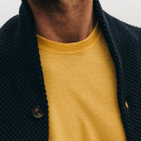 fit model wearing The Cotton Hemp Tee in Gold, sweater overlaying