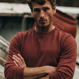 fit model wearing The Crewneck in Brick Red Terry, arms crossed