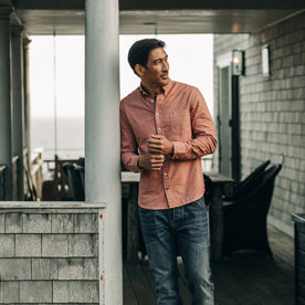 fit model rocking The Jack in Dusty Rose Oxford, leaning against beam of house