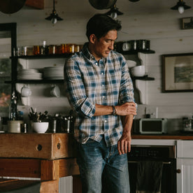 fit model wearing The Jack in Melange Navy Plaid, playing with sleeves, in kitchen