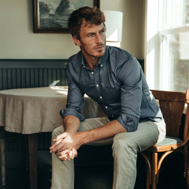 fit model wearing The Jack in Ocean Oxford, sitting, hands clasped