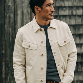 fit model wearing The Long Haul Jacket in Natural Organic Selvage, looking right