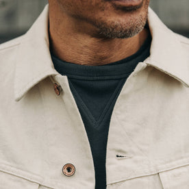 fit model wearing The Long Haul Jacket in Natural Organic Selvage, cropped chest shot