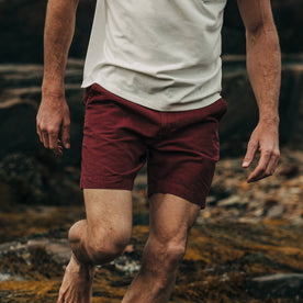 fit model wearing The Morse Short in Brick Red Slub Linen, cropped chest down