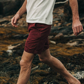 fit model wearing The Morse Short in Brick Red Slub Linen, walking left of camera