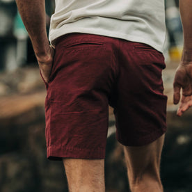 fit model wearing The Morse Short in Brick Red Slub Linen, back detail