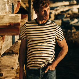 fit model wearing The Organic Cotton Tee in Gold Stripe, hand in pocket