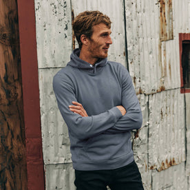 fit model wearing The Shackleton Hoodie in Ocean, arms crossed, looking right