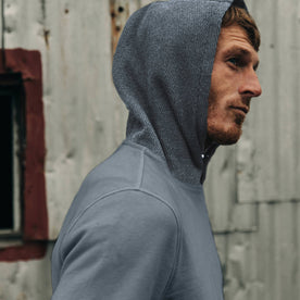 fit model wearing The Shackleton Hoodie in Ocean, hoodie up, cropped shot