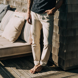 fit model wearing The Slim Jean in Natural Organic Selvage, hand in pocket