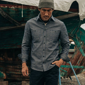 fit model rocking The Utility Shirt in Indigo Crosshatch, walking in boat yard