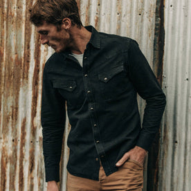 fit model wearing The Western Shirt in Washed Black Selvage Chambray, hand in pocket