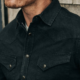 fit model wearing The Western Shirt in Washed Black Selvage Chambray, cropped chest shot