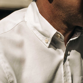 our fit model wearing The Short Sleeve Jack in Washed White Oxford outside on a fence—closeup shot of collar