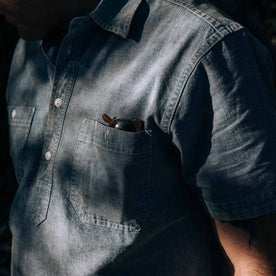 our fit model wearing The Short Sleeve Popover in Blue Chambray—cropped shot of sleeve and pocket